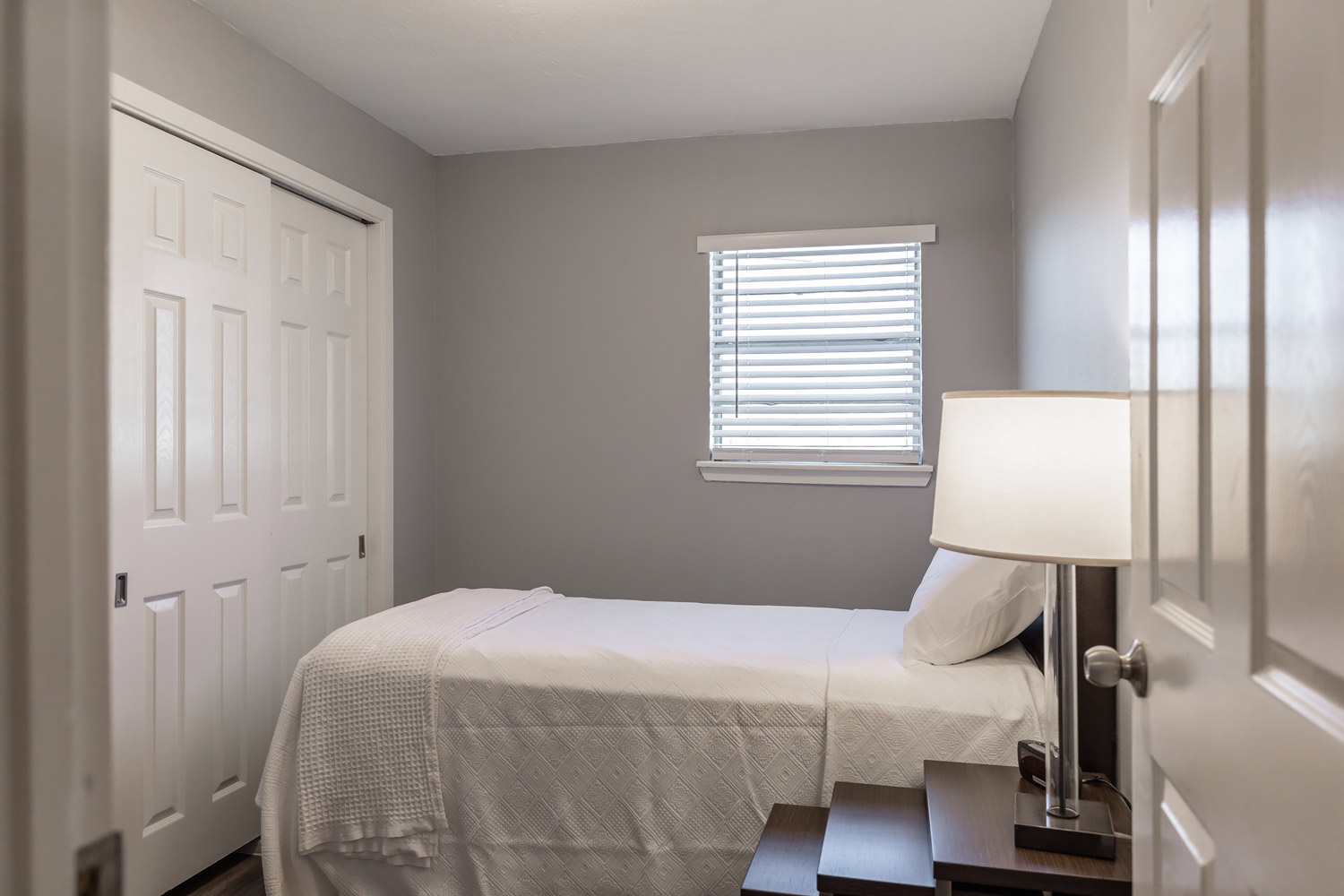 Warm Color Scheme Bedroom at The Five Points at Texas Apartments in Texas City, Texas