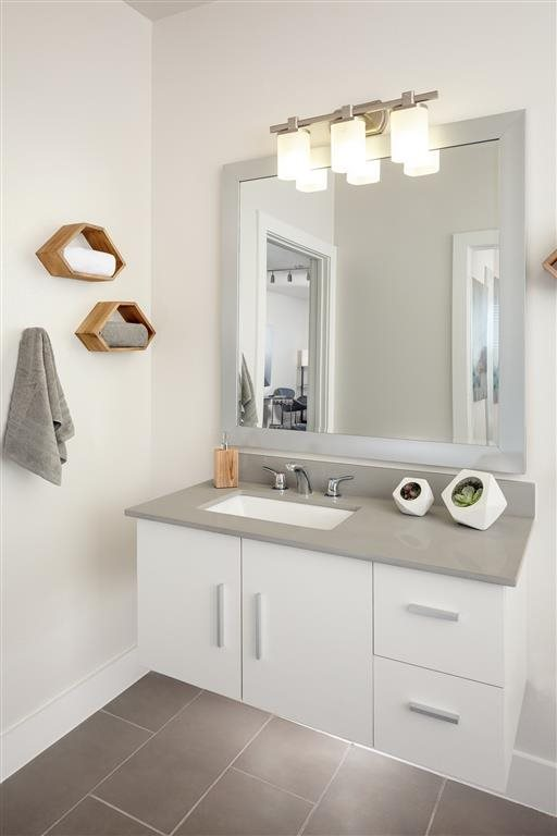 Porcelain Sinks w/ Pebble Gray Counters at The Flats at Big Tex Apartments in San Antonio, TX