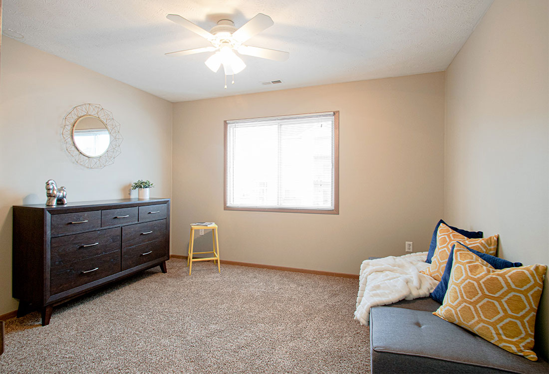 Spacious Bedrooms with Ceiling Fans at Flatwater Apartments in La Vista, Nebraska