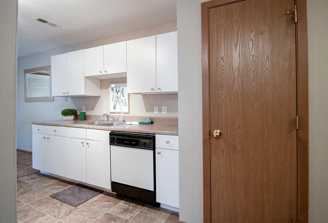 Kitchens with Pantries at Flatwater Apartments in La Vista, Nebraska