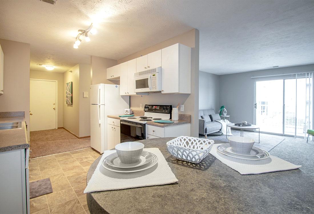 Kitchens with Upgraded Lighting at Flatwater Apartments in La Vista, Nebraska