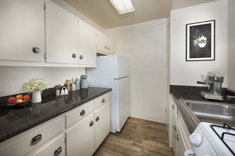 Galley-style kitchen at Flower Branch Apartments in Silver Spring, MD