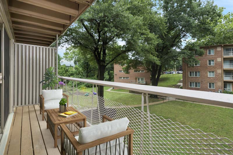 Relaxing covered balcony at Flower Branch Apartments in Silver Spring, MD