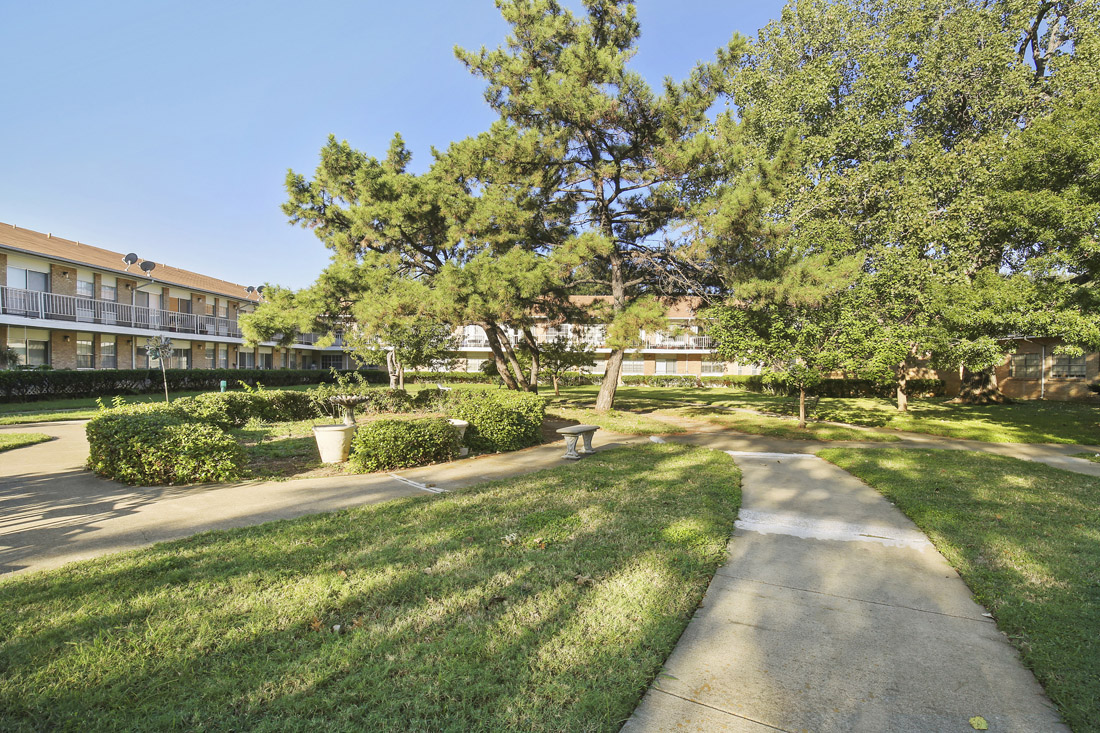 Tranquil Community Courtyard at Forest Dale Apartments in Dallas, Texas