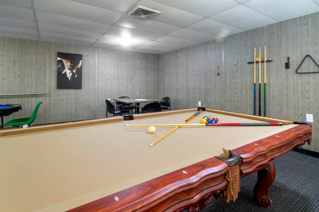 Game Room with Billiards at Forest Dale Apartments in Dallas, Texas