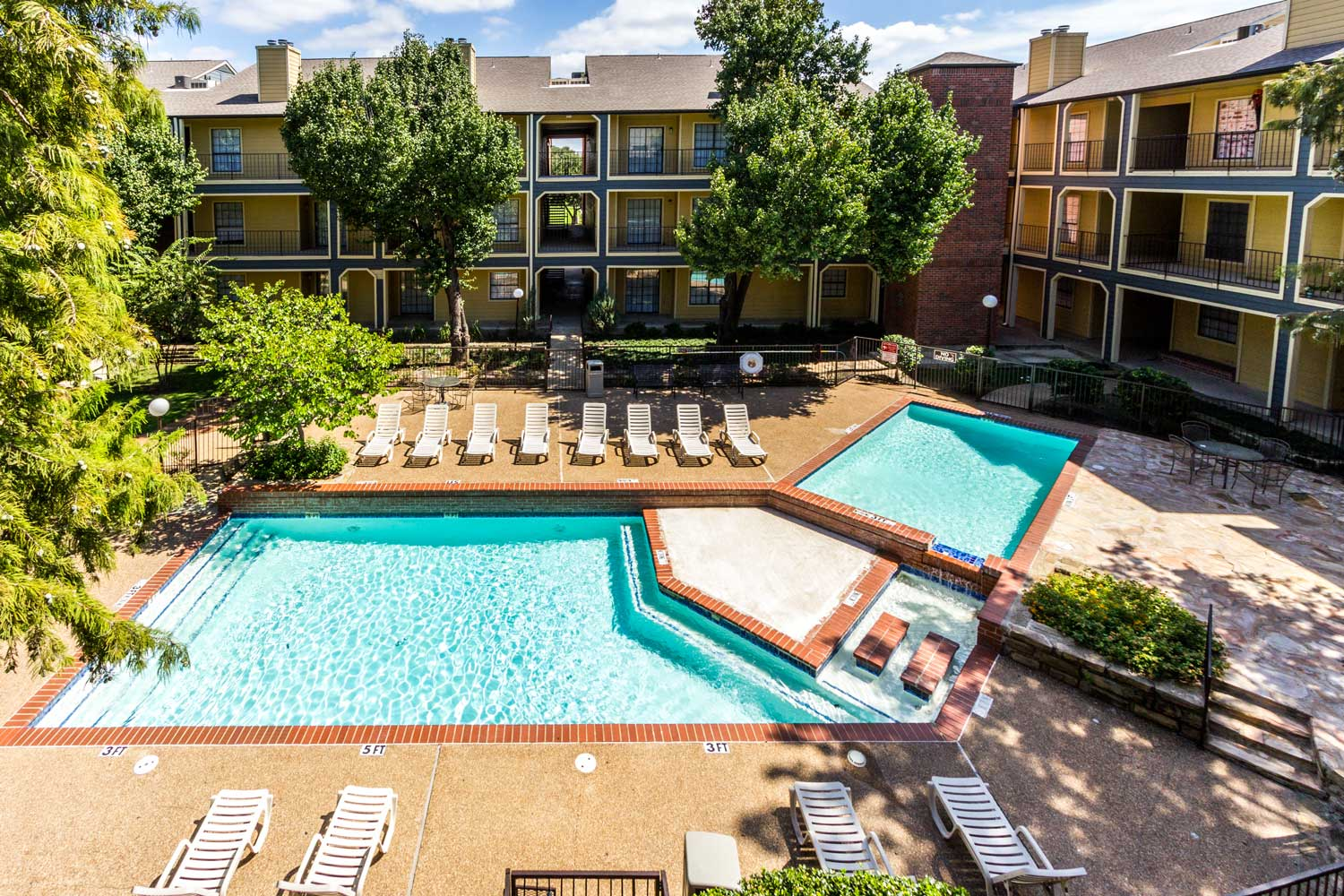 Large Swimming Pool with Sun Deckat Forest Hills Apartments in Dallas, TX