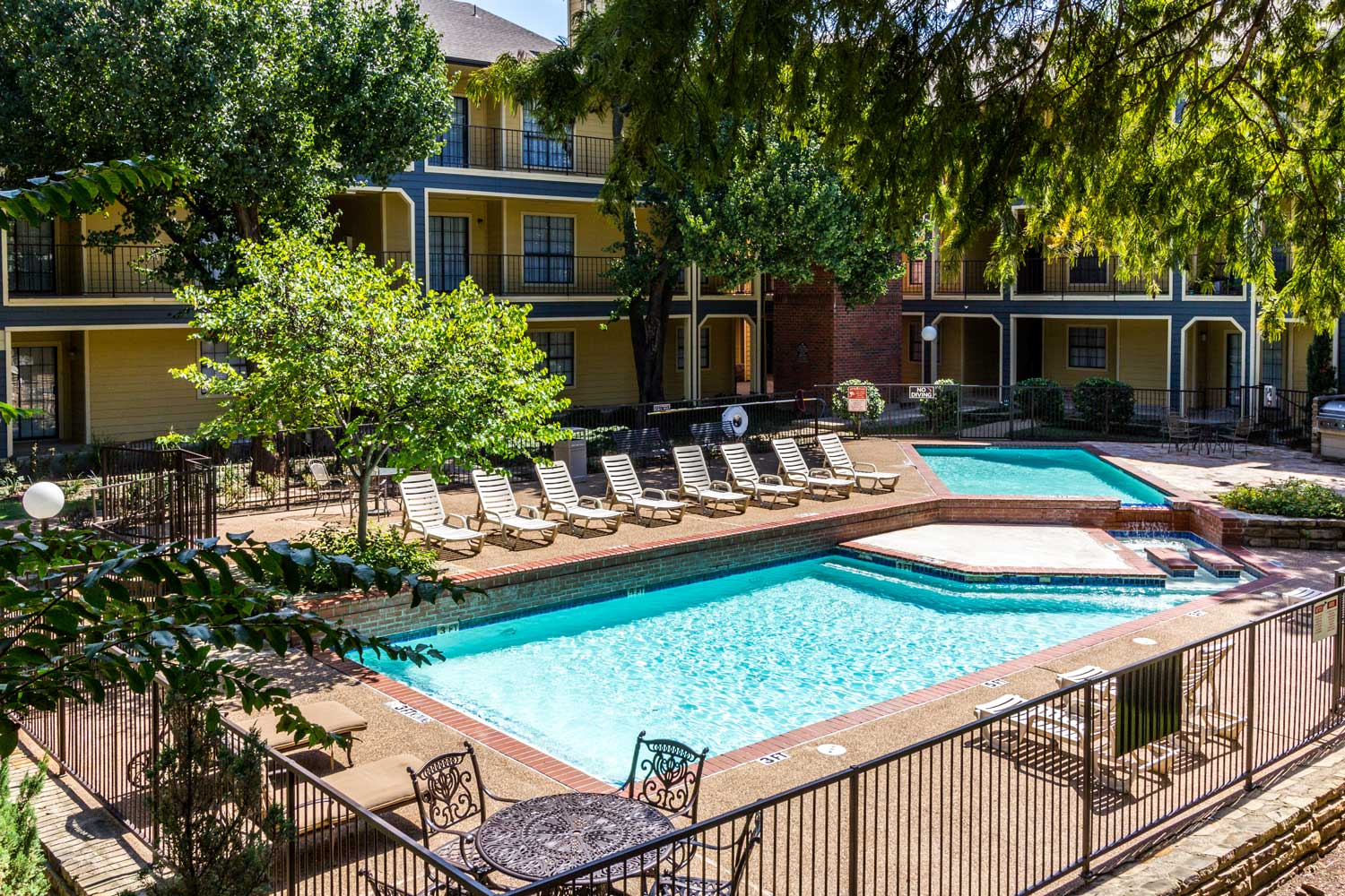Outdoor Swimming Pool with Sun Deckat Forest Hills Apartments in Dallas, TX