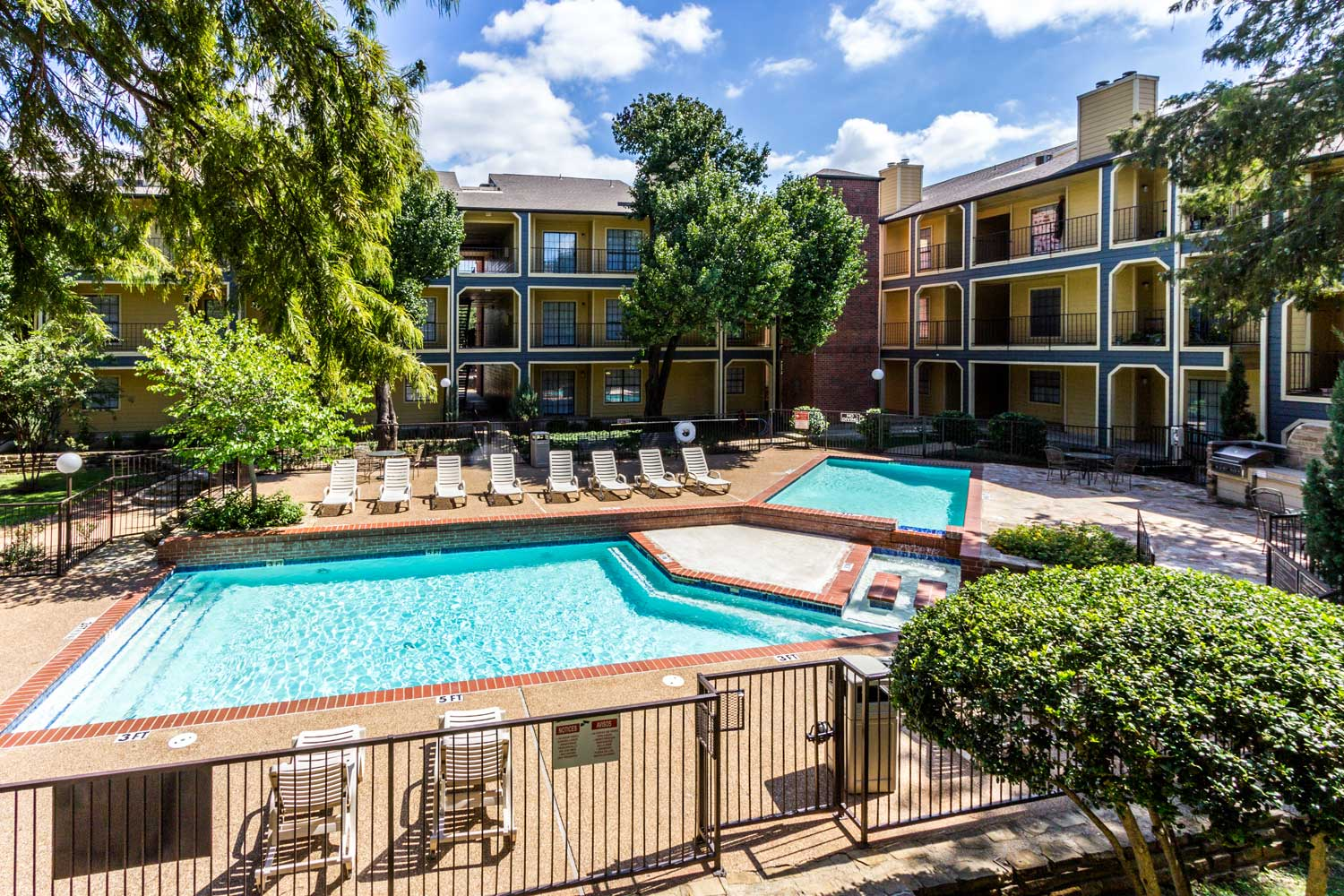 Resort-Style Swimming Pool with Sun Deckat Forest Hills Apartments in Dallas, TX