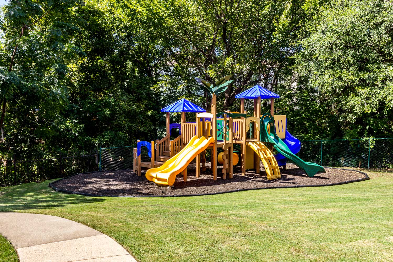 Children's Play Structure with Slide at Forest Hills Apartments in Dallas, TX