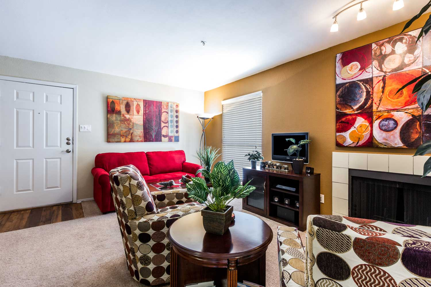 Wood-Burning Fireplace with Tile Accentsat Forest Hills Apartments in Dallas, TX