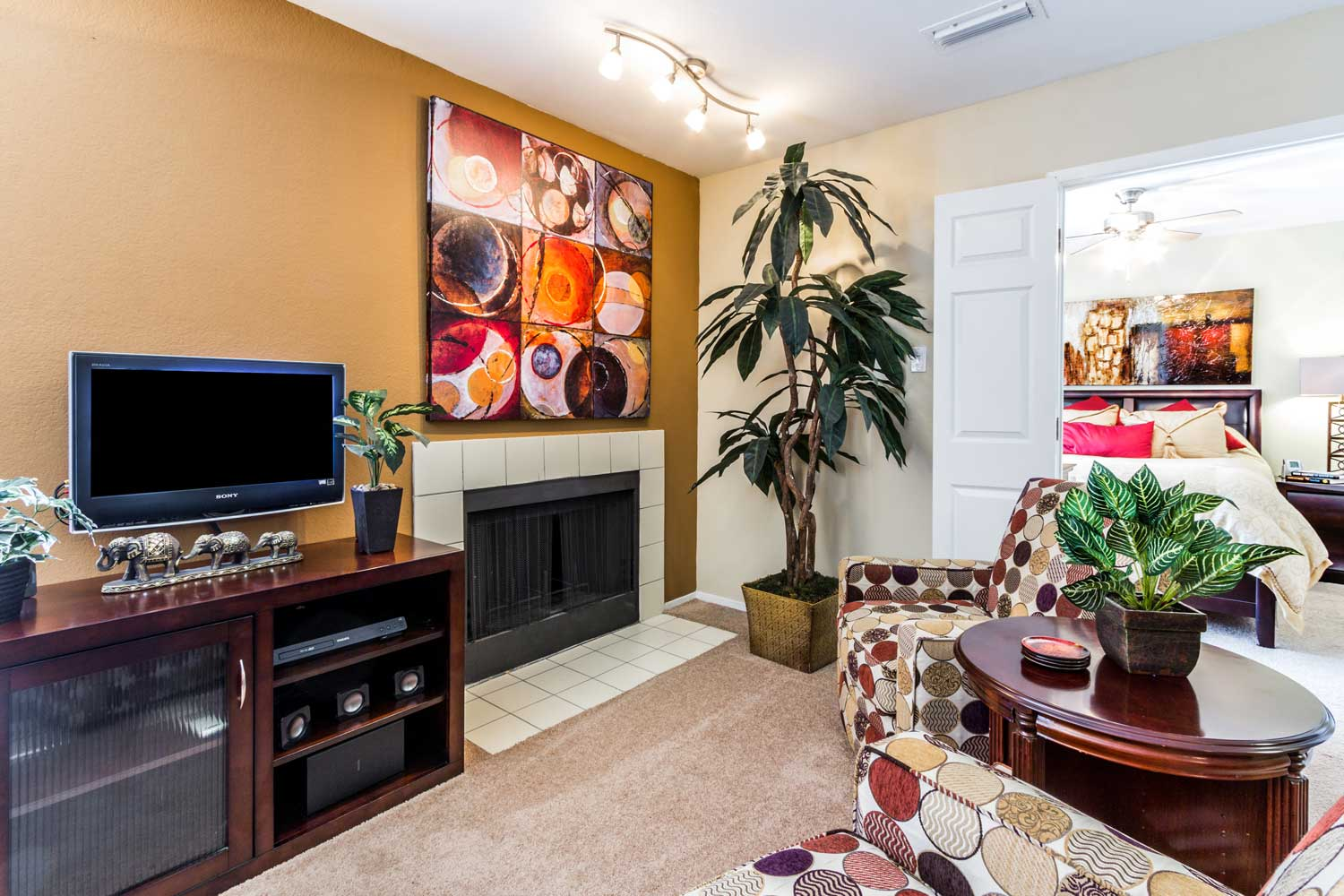 Wood-Burning Fireplace with Tile Accents at Forest Hills Apartments in Dallas, TX