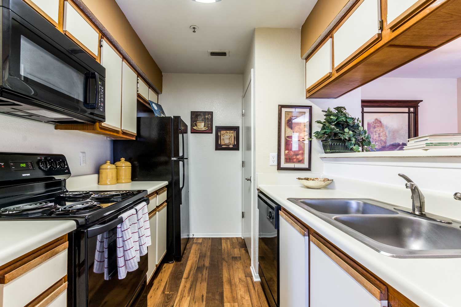Galley-Style Kitchenat Forest Hills Apartments in Dallas, TX