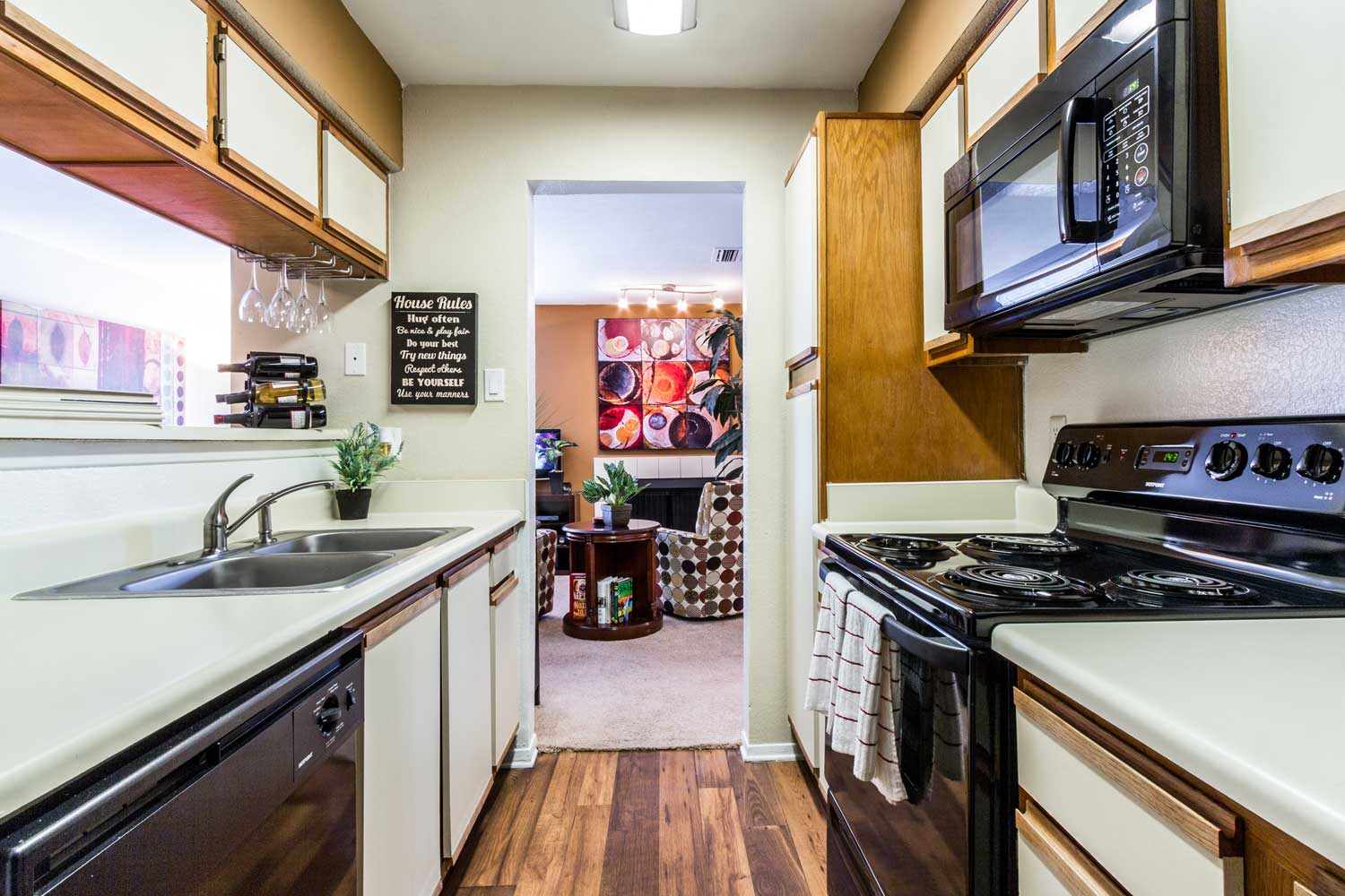 Kitchen with Wood-Look Flooring at Forest Hills Apartments in Dallas, TX