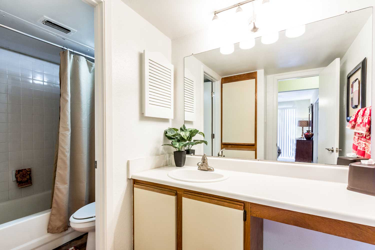 Stylish Bathroom with Vanity at Forest Hills Apartments in Dallas, TX