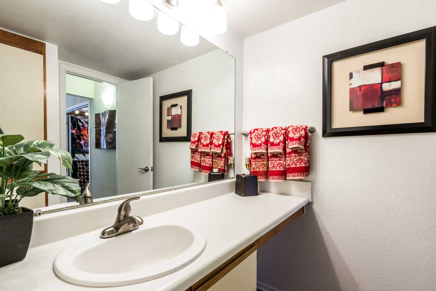 Bathroom with Mirror and Ample Storage at Forest Hills Apartments in Dallas, TX