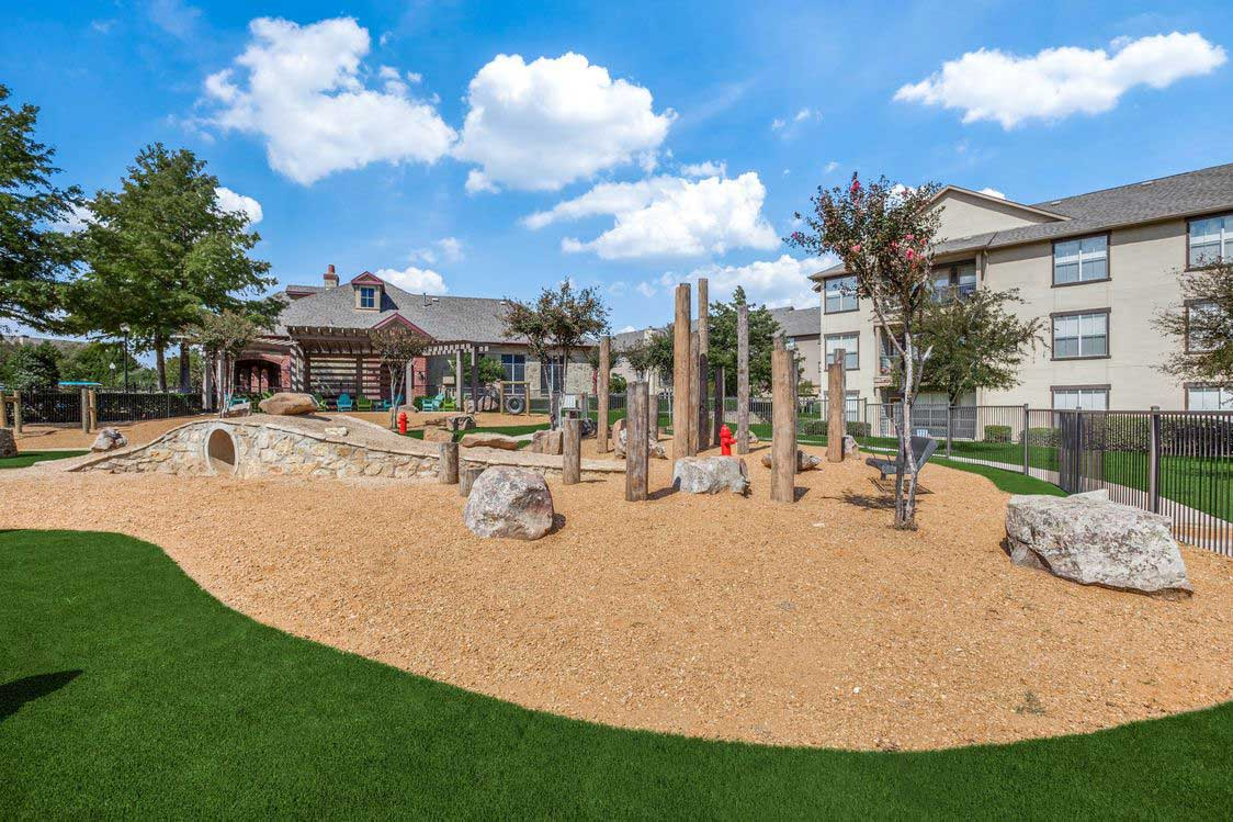 Playground at The Ranch at Fossil Creek Apartments in Haltom City, TX