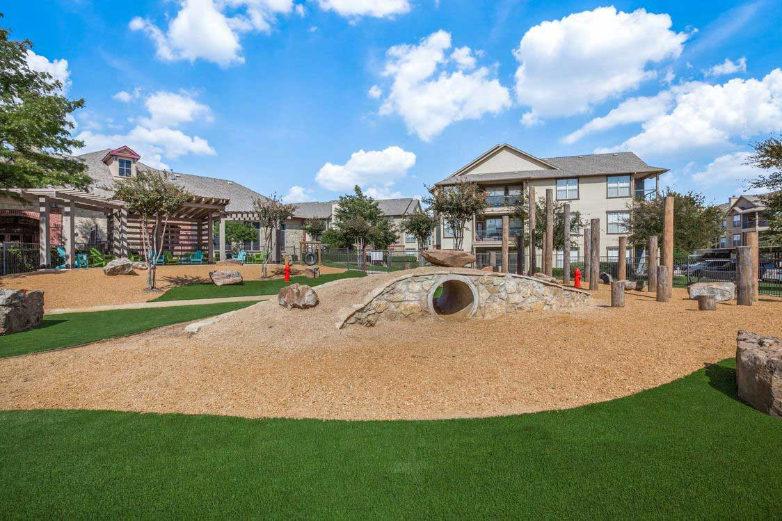 Lush Landscaping at The Ranch at Fossil Creek Apartments in Haltom City, TX
