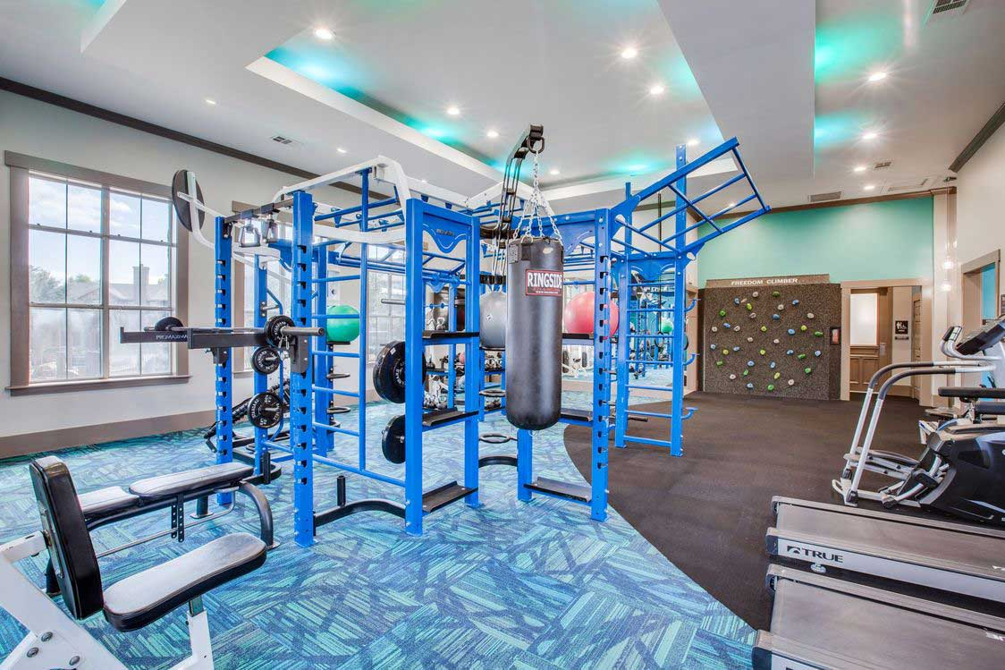Strength Training Equipment at The Ranch at Fossil Creek Apartments in Haltom City, TX