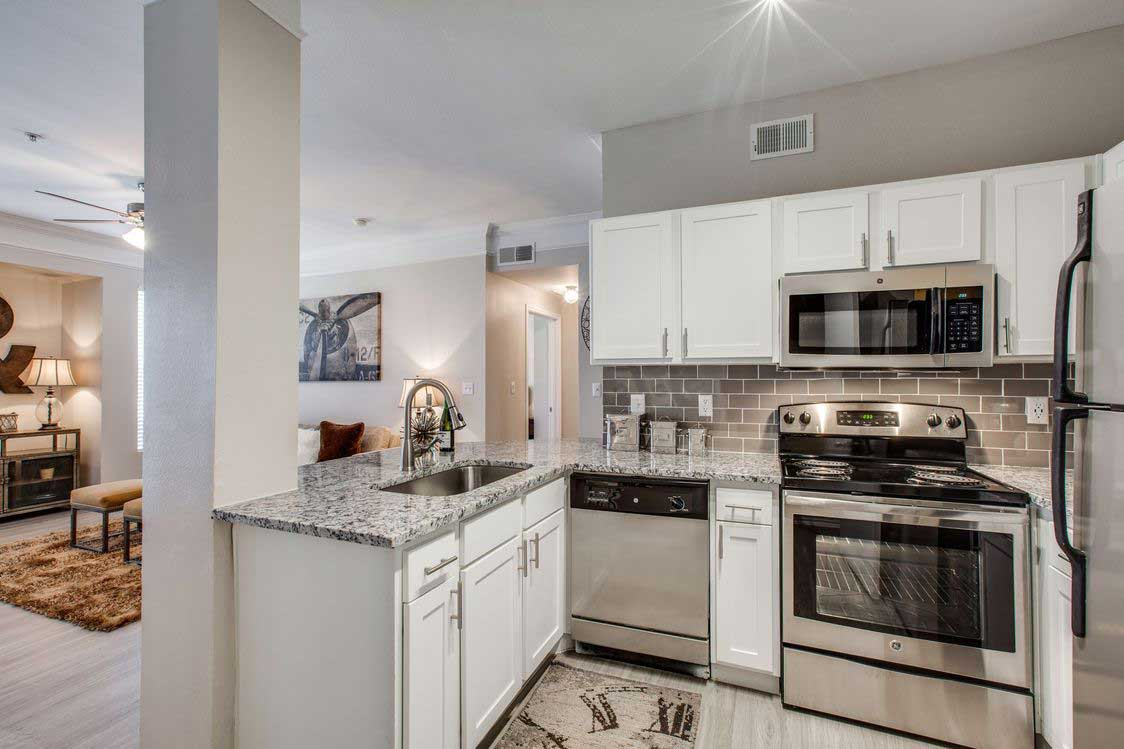 Stainless Steel Appliances at The Ranch at Fossil Creek Apartments in Haltom City, TX