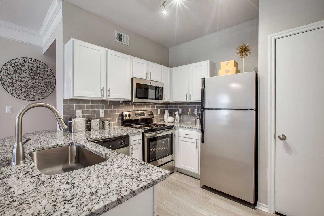 Granite Countertops at The Ranch at Fossil Creek Apartments in Haltom City, TX