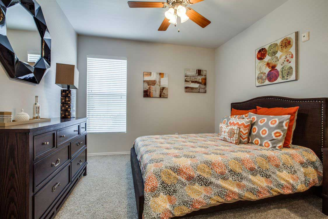 Bedrooms with Ceiling Fans at The Ranch at Fossil Creek Apartments in Haltom City, TX
