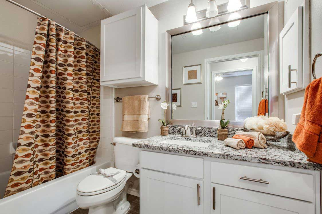 Bathrooms with Storage at The Ranch at Fossil Creek Apartments in Haltom City, TX