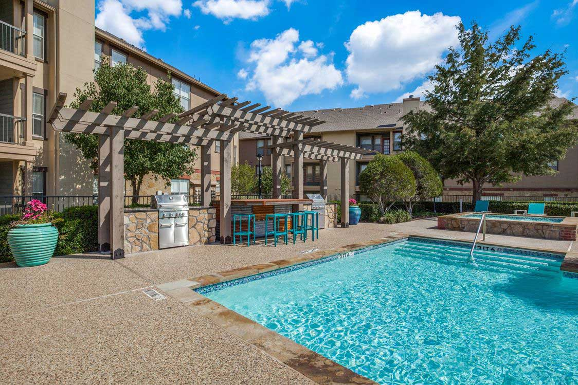Resort-Style Pool at The Ranch at Fossil Creek Apartments in Haltom City, TX