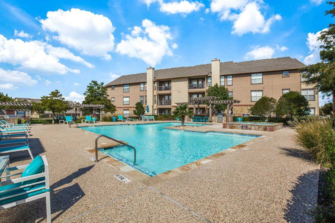 Sparkling Swimming Pool at The Ranch at Fossil Creek Apartments in Haltom City, TX