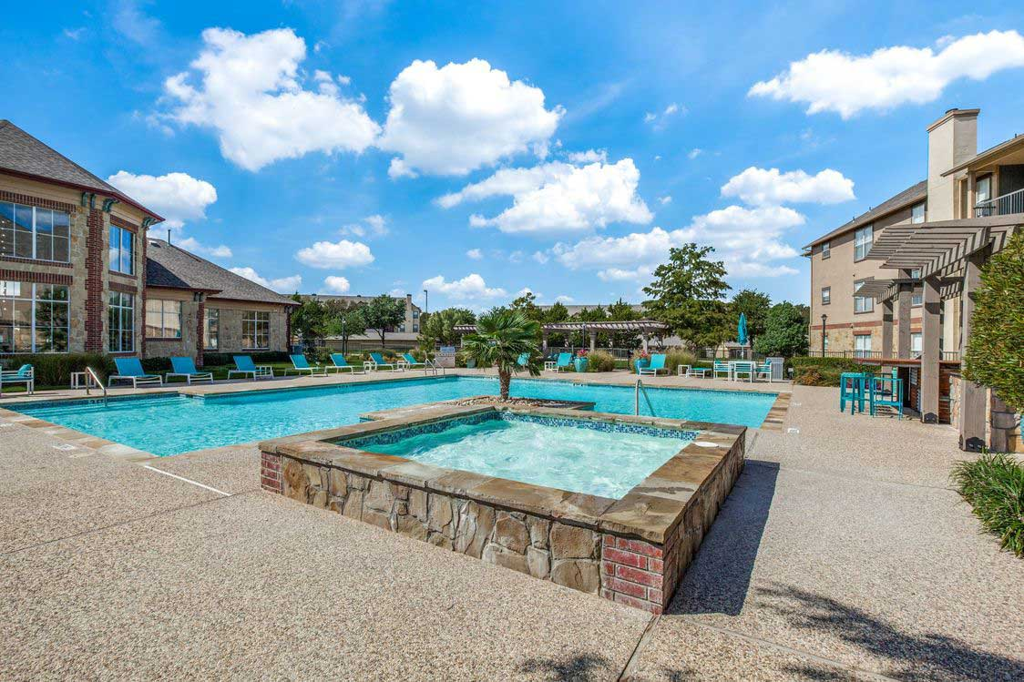 Pool with Hot Tub at The Ranch at Fossil Creek Apartments in Haltom City, TX