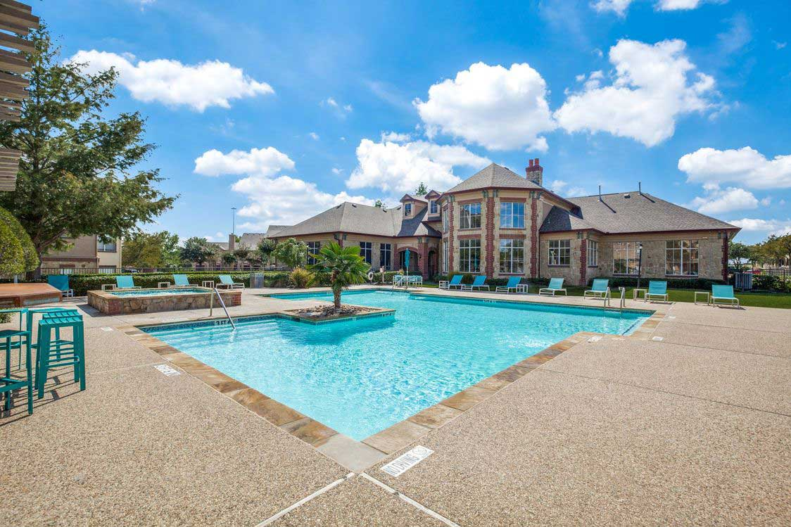 Relaxing Swimming Pool at The Ranch at Fossil Creek Apartments in Haltom City, TX