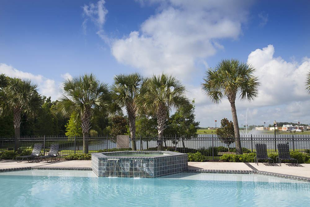 Resort Style Pool at The Village at Fountain Lake Apartments in Gonzales, Louisiana