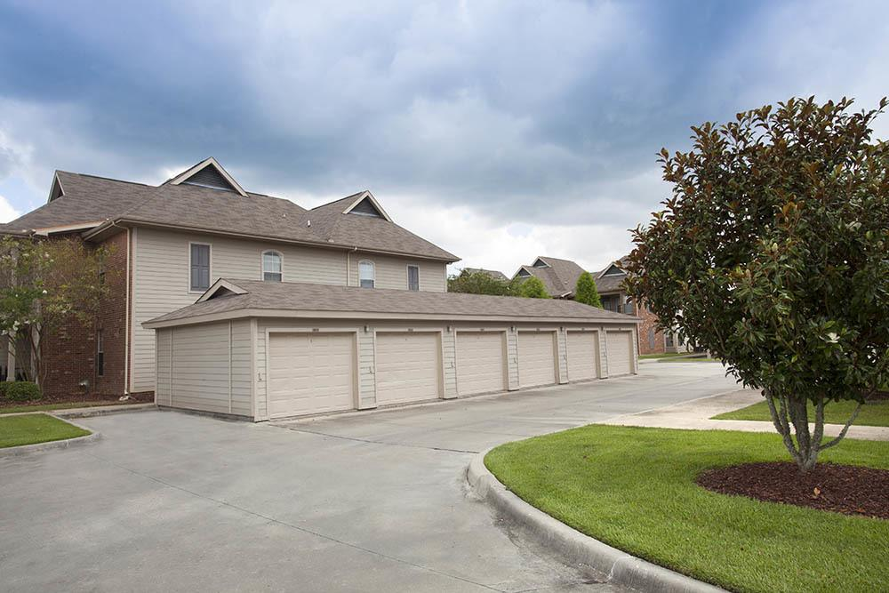 Detached Garages at The Village at Fountain Lake Apartments in Gonzales, Louisiana