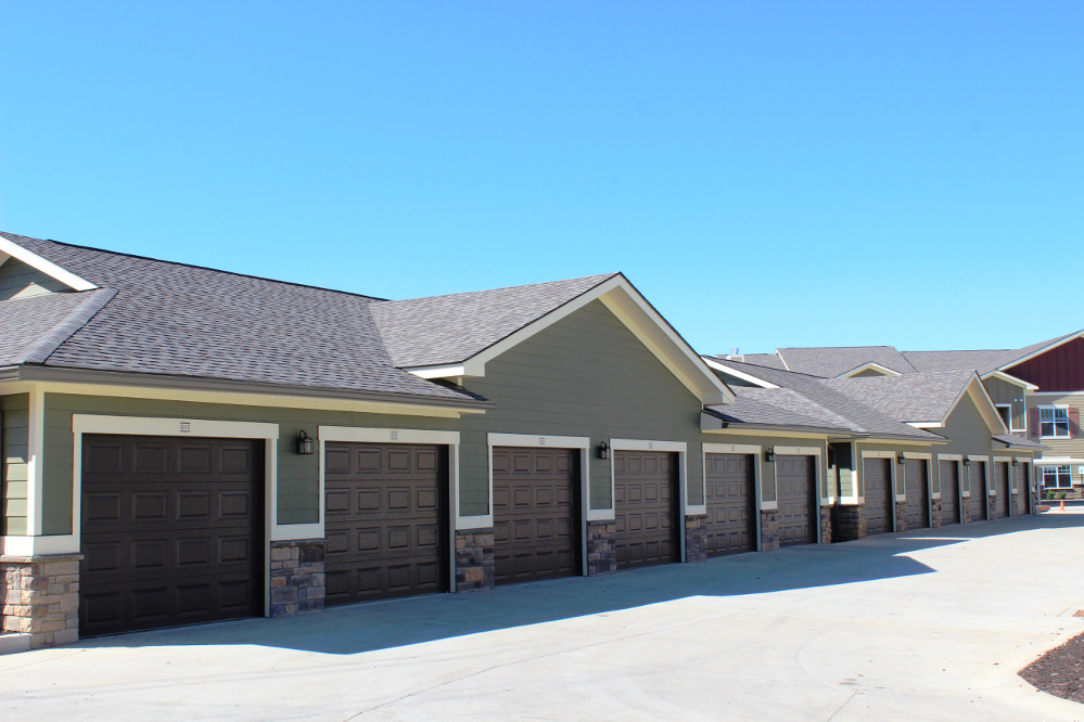 Exterior with Garage at the Reserve at Fountainview Apartments in Saint Charles, MO
