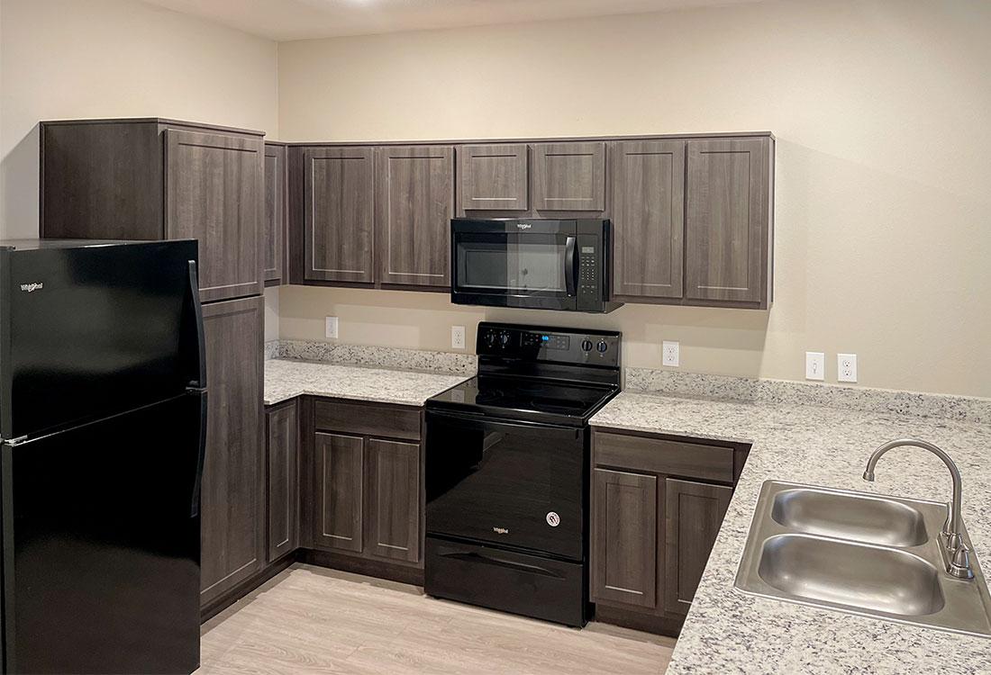 Kitchens with Granite Countertops at Gala at Texas Parkway Apartments in Missouri City, Texas