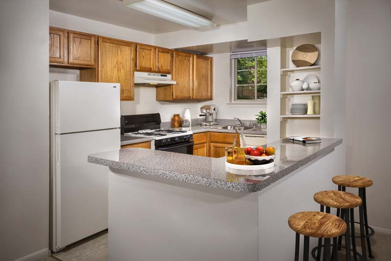 Well-equipped kitchen with breakfast bar at Gateway Square Apartments