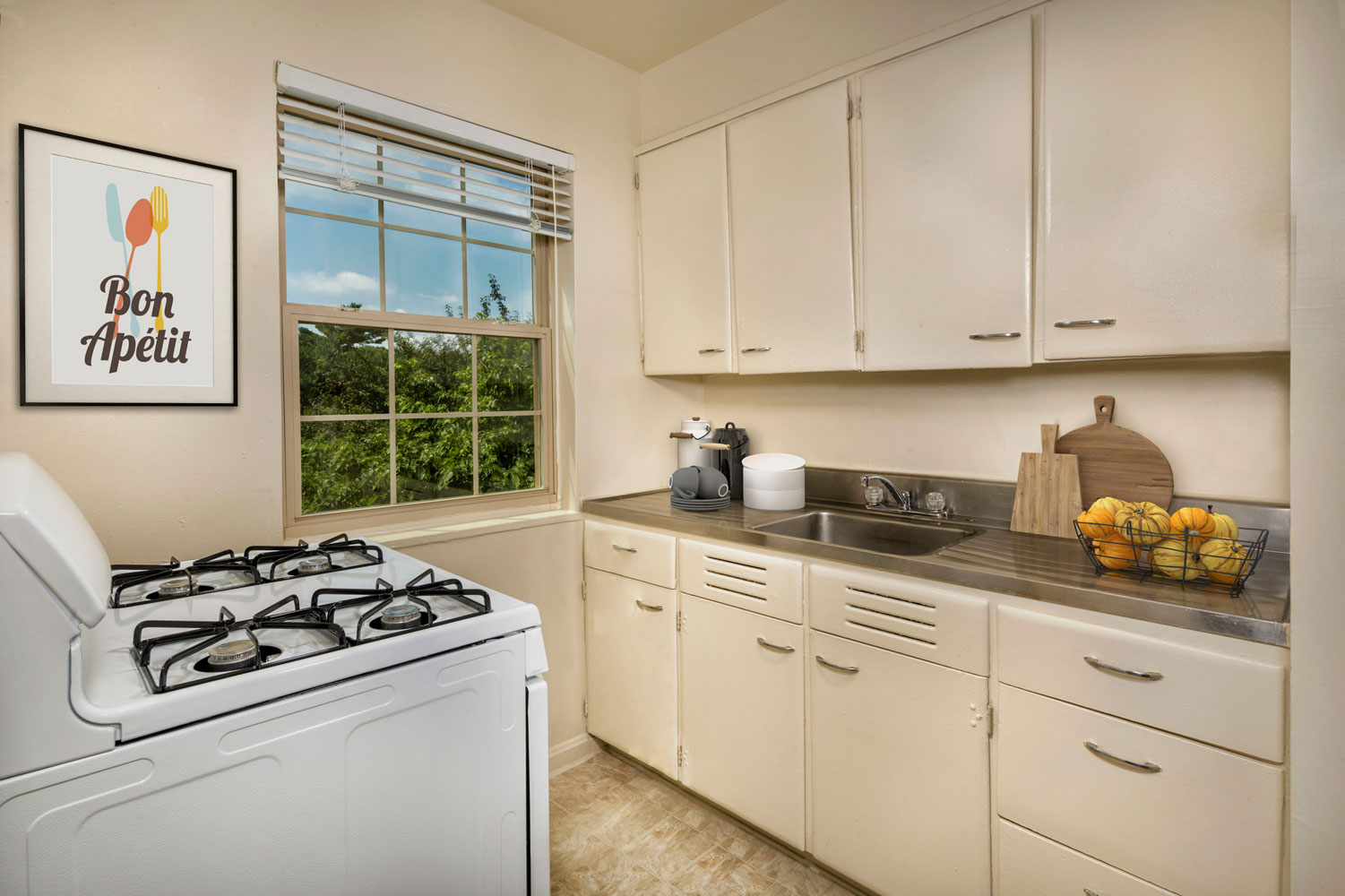 Kitchen with gas stove at Goodacre & Pine Ridge Apartments in Silver Spring, MD