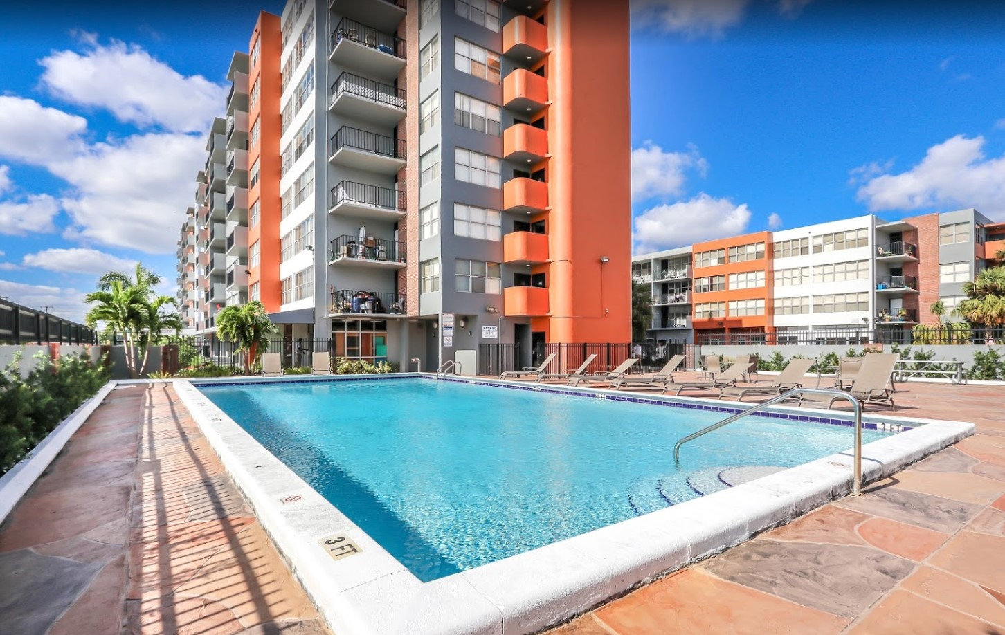 Sparkling Swimming Pool at Grand Island Square Apartments in North Miami Beach, Florida
