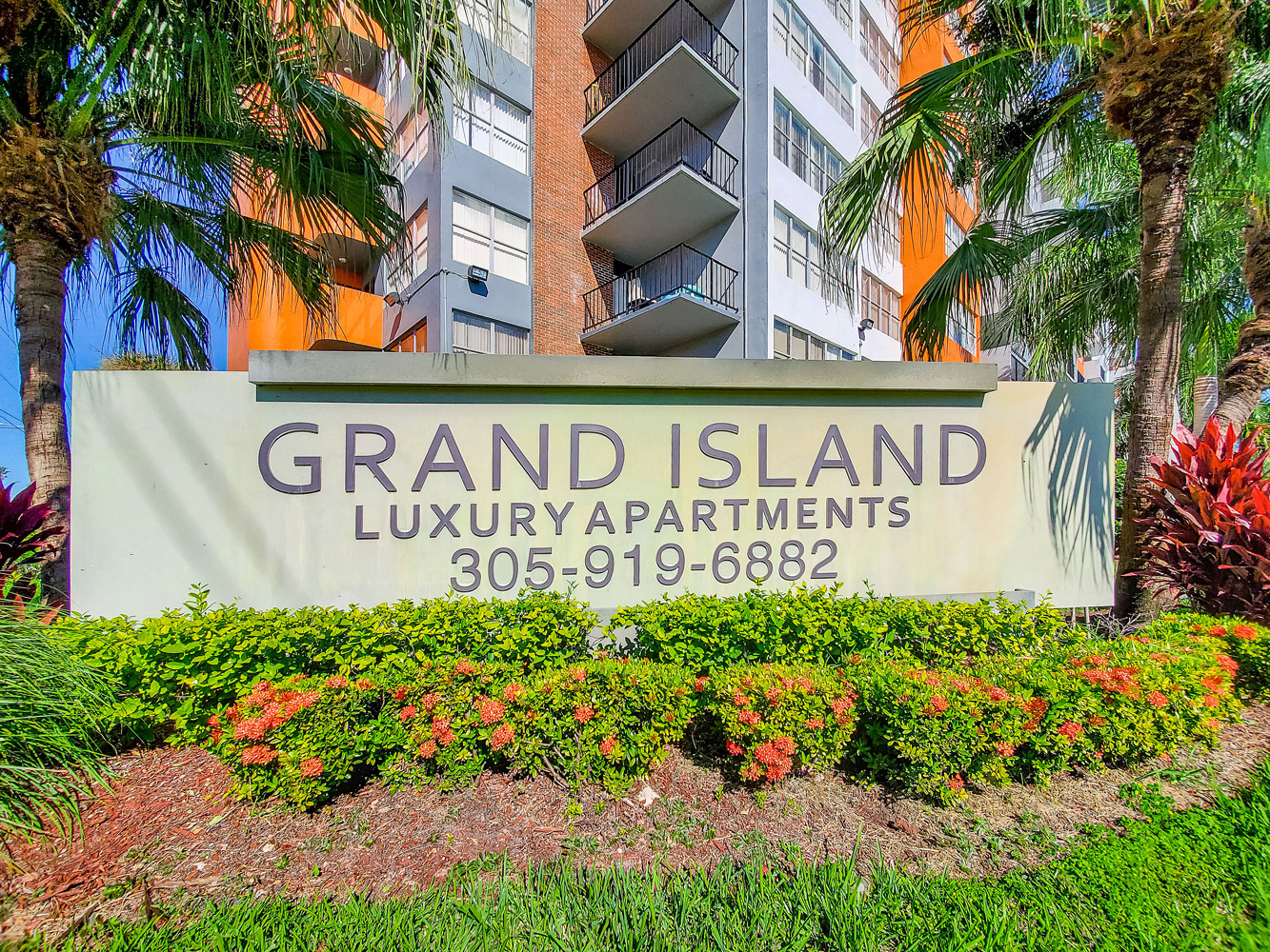 Welcome Sign  at Grand Island Square Apartments in North Miami Beach, Florida