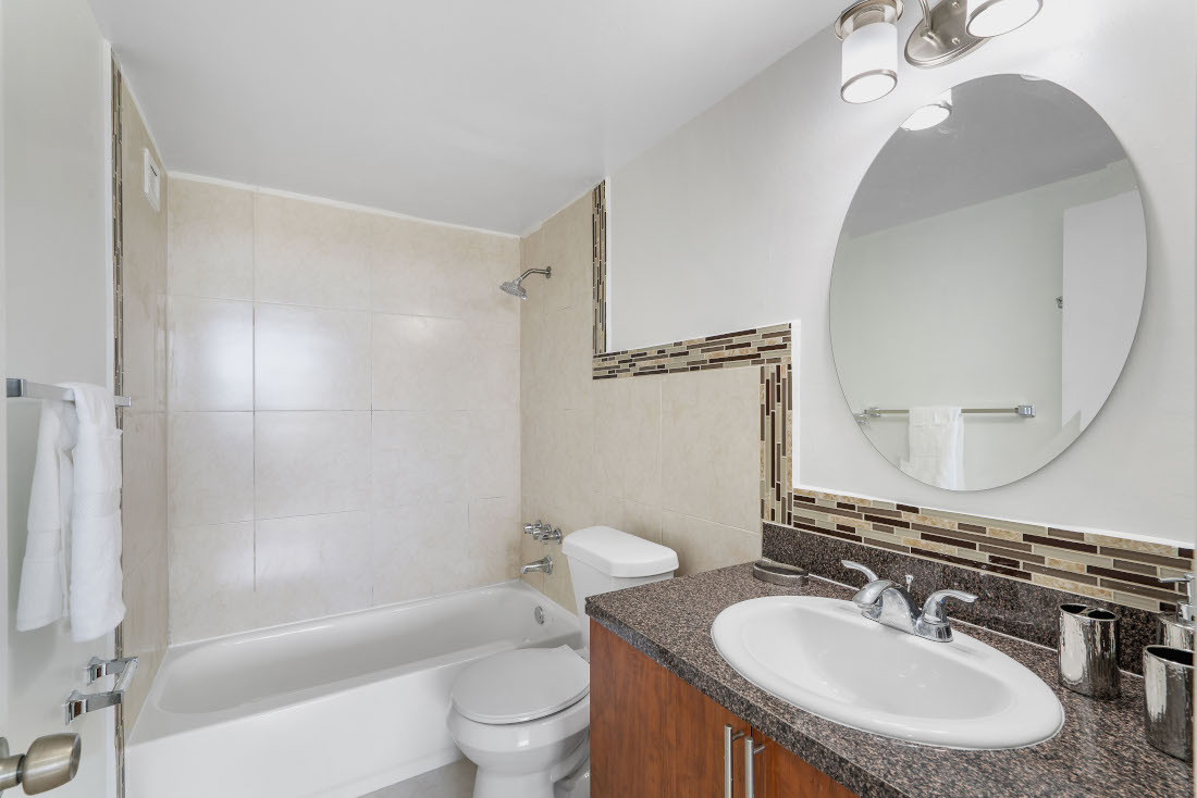White Bathroom  at Grand Island Square Apartments in North Miami Beach, Florida