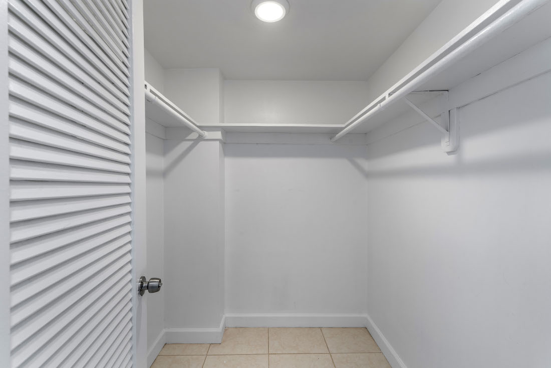 White Closet  at Grand Island Square Apartments in North Miami Beach, Florida