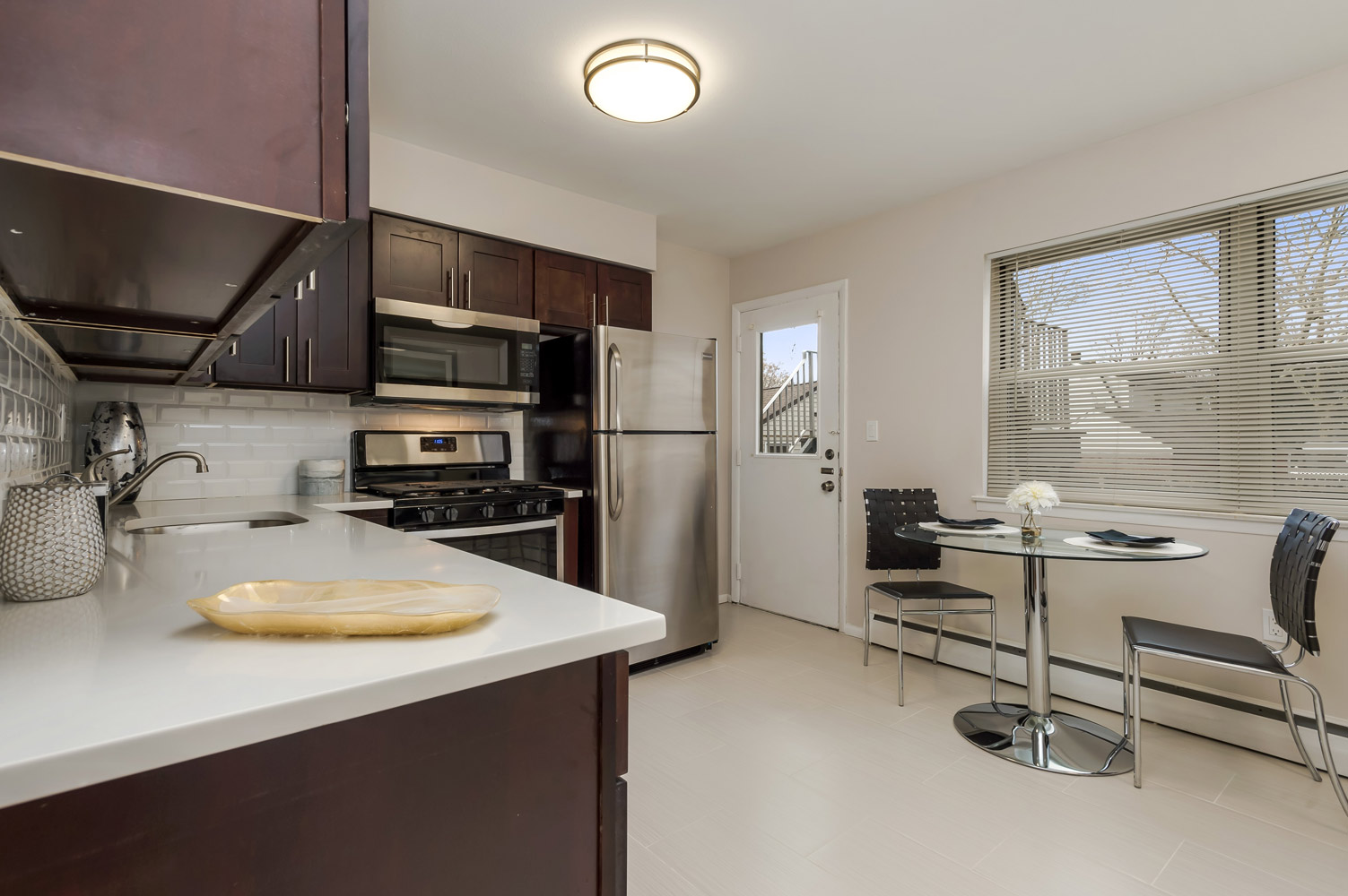 Kitchen with Dining Area at Grandview Gardens Apartments in Edison, New Jersey