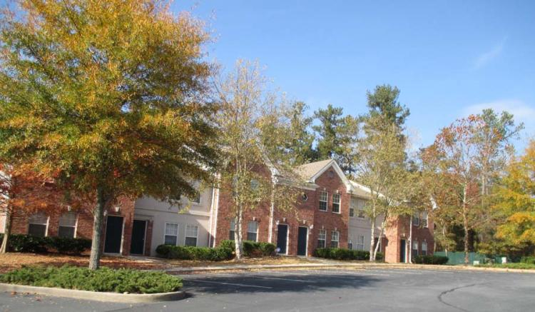 Exterior at the Greens At Stonecreek Apartments in Lithonia, GA