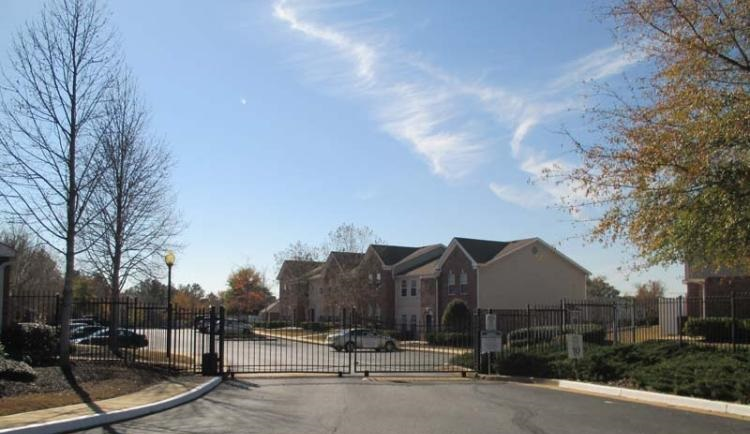 Exterior View at the Greens At Stonecreek Apartments in Lithonia, GA