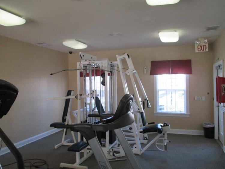 Fitness Center at the Greens At Stonecreek Apartments in Lithonia, GA