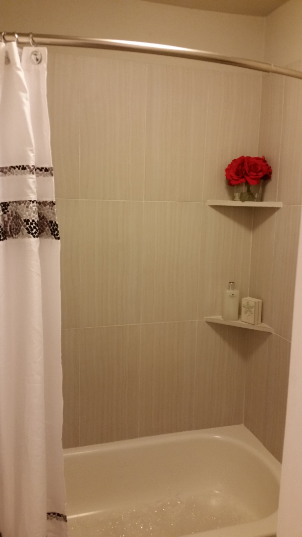 Bathtub and Shower at Grove on Gladstell Apartments in Conroe, Texas