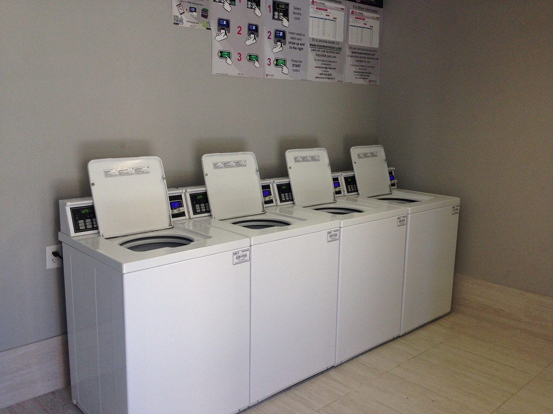 Laundry Center at Grove on Gladstell Apartments in Conroe, Texas