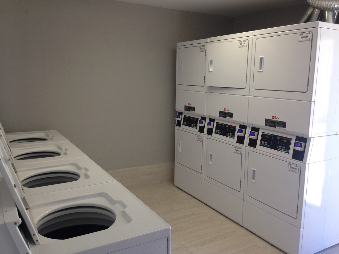 Laundry Facility On-Site at Grove on Gladstell Apartments in Conroe, Texas