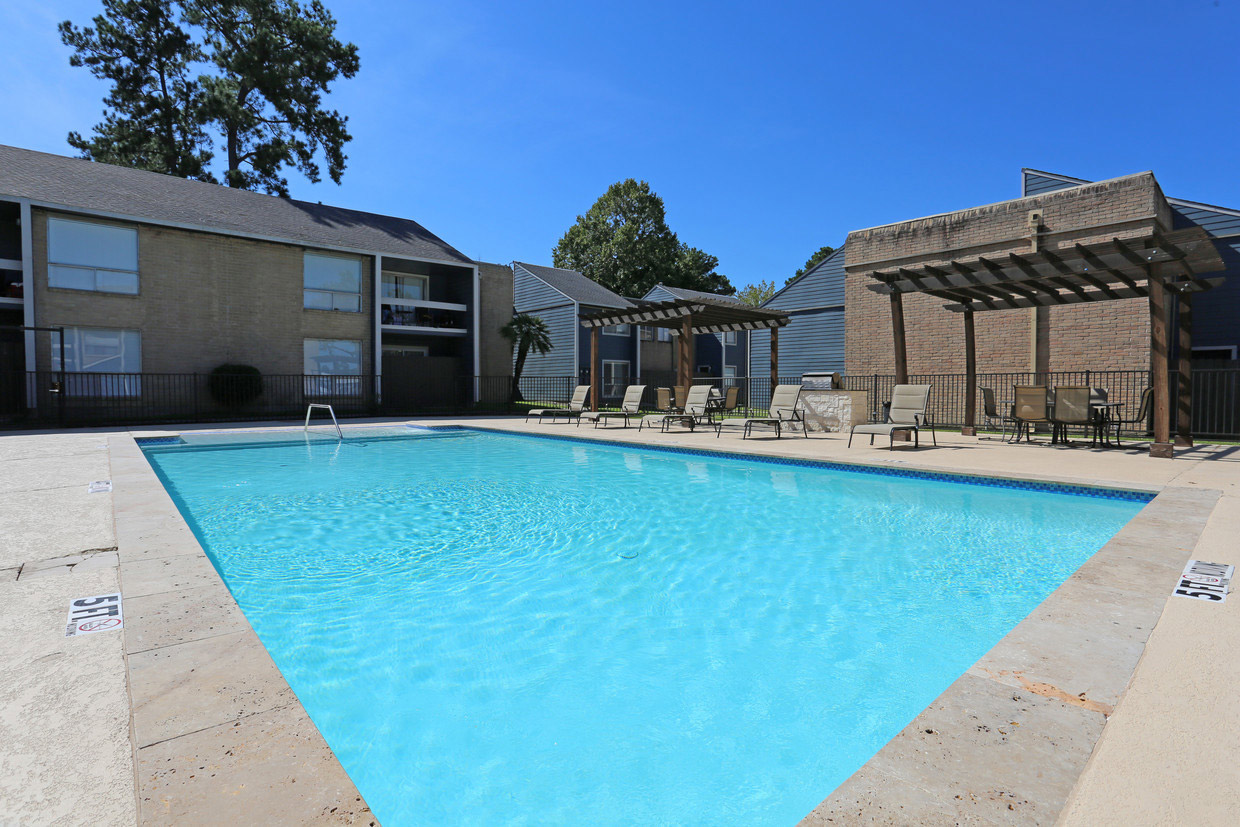 Shimmering Swimming Pool at Grove on Gladstell Apartments in Conroe, Texas