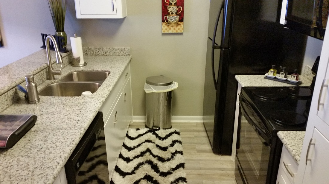 Black Appliances at Grove on Gladstell Apartments in Conroe, Texas