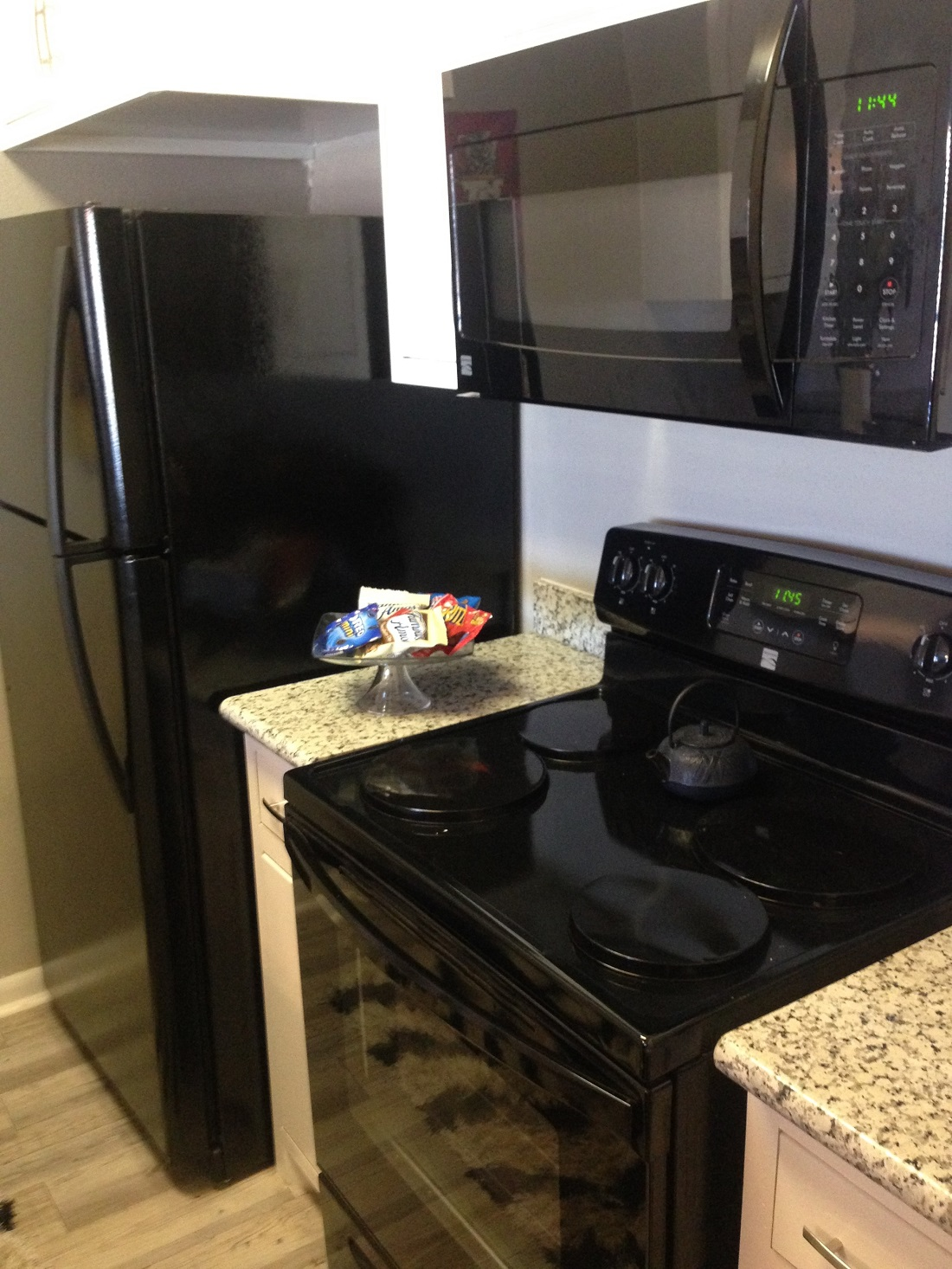 Microwave, Oven, and Range at Grove on Gladstell Apartments in Conroe, Texas